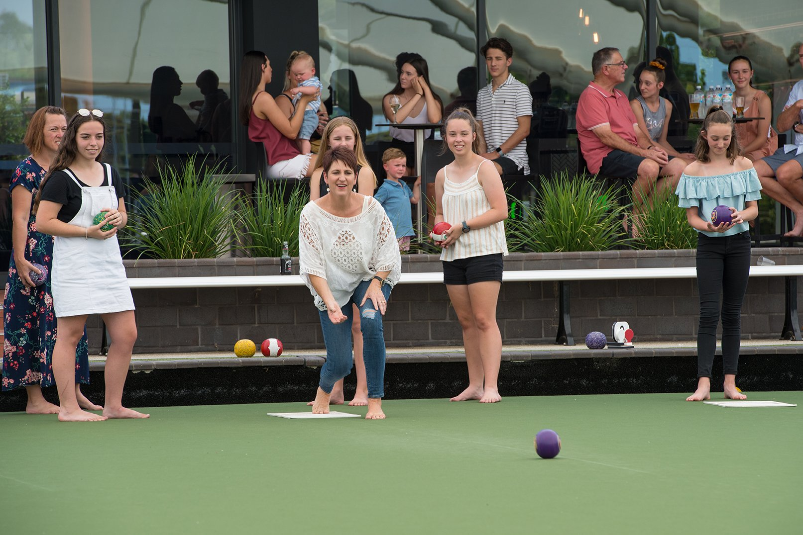 Family playing lawn bowls at moama bowling club