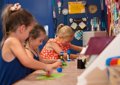 Kids playing with craft activities in the kids' kave at moama bowling club