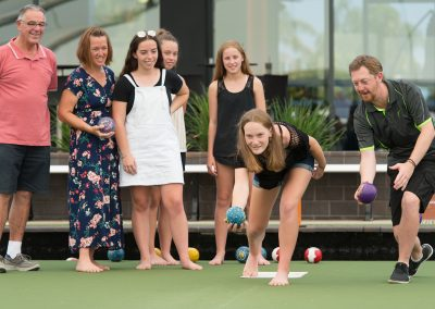 Junior lawn bowler getting coached at moama bowling club