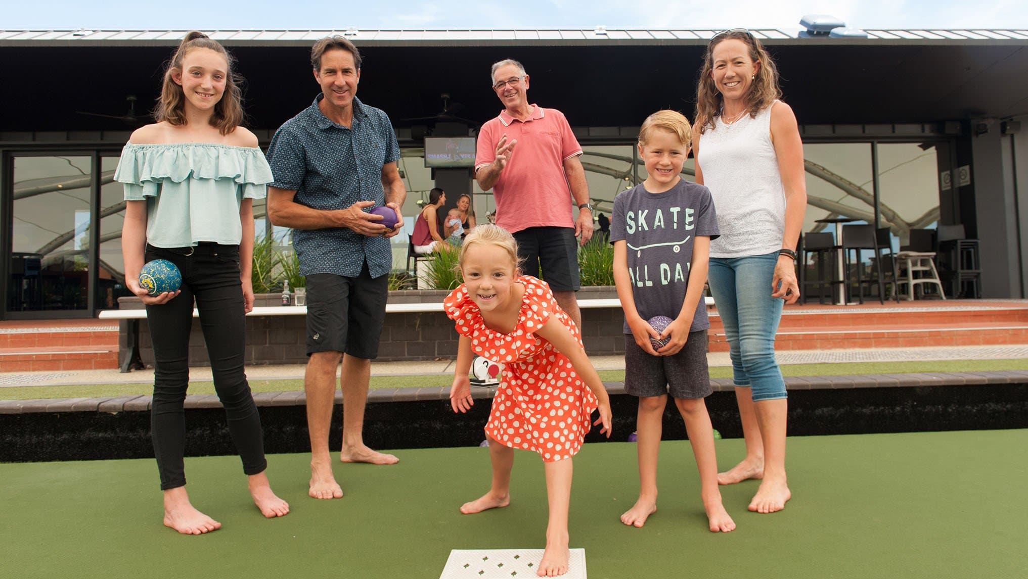 family playing bowls